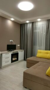 Living room renovation with paintable wallpaper and light laminate